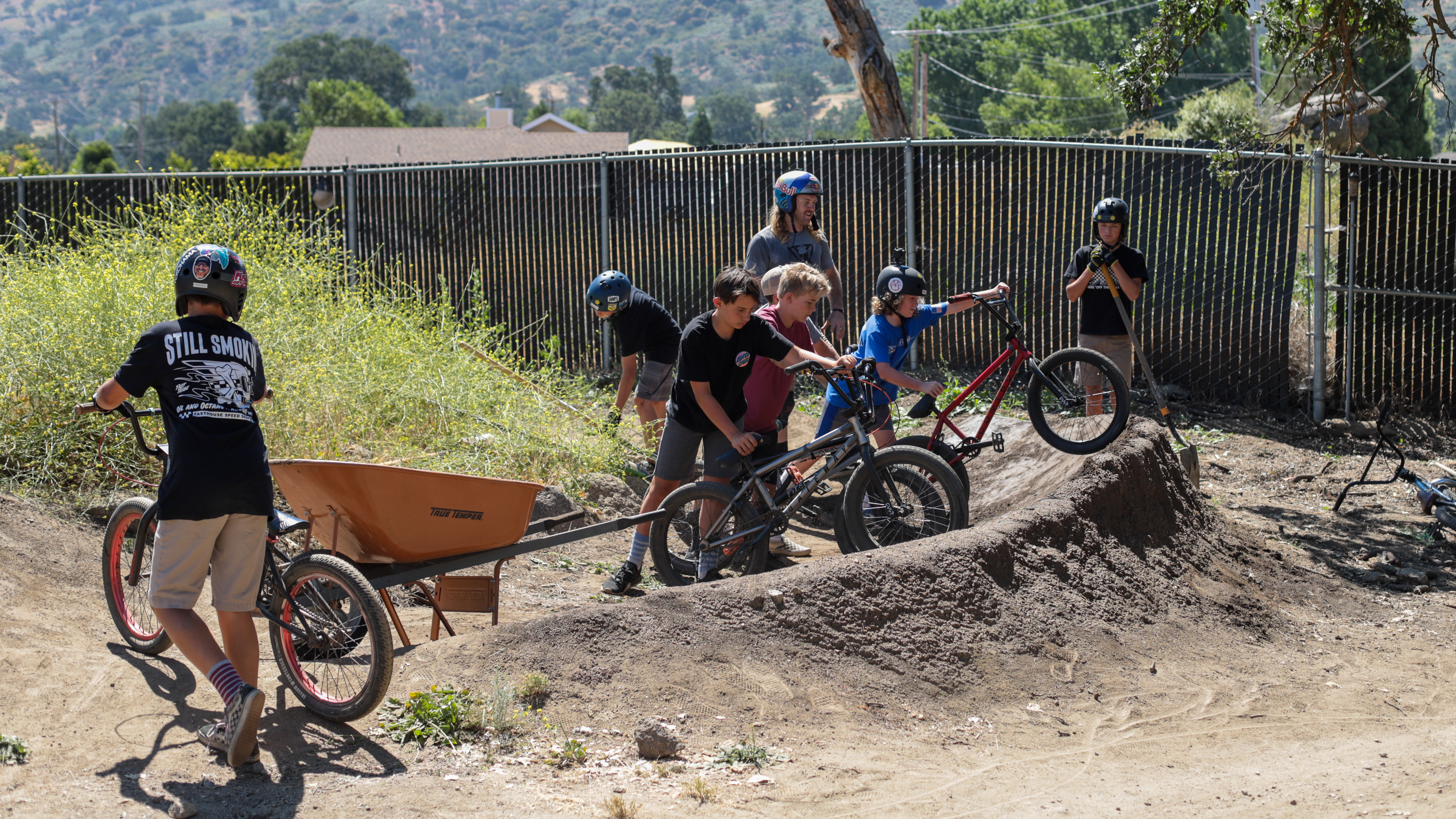 Mike Hucker and campers building a dirt hill